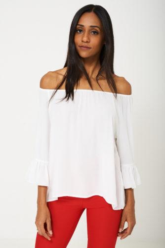 Laienevate varrukatega pluus valge